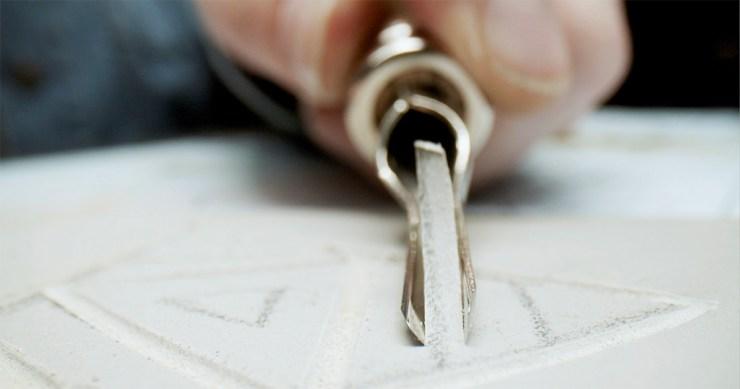 Linocut printmaking step 3: Carve out design