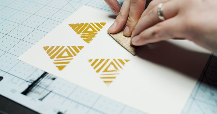 Linocut printmaking step 6: apply stamp to paper