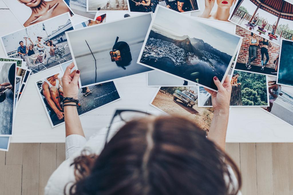 Adding Freelance Work to Resume - Girl looking at photos