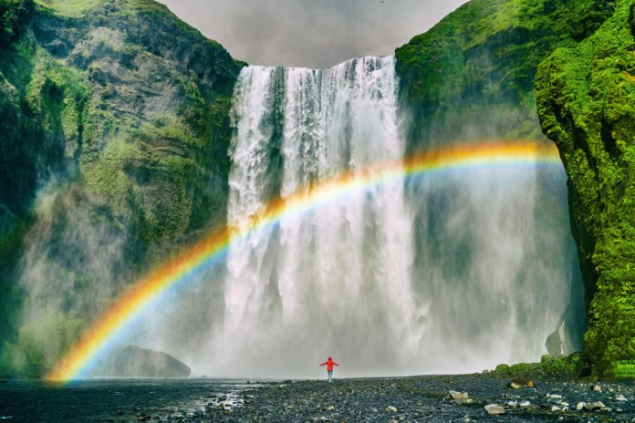 Rainbow Rising from a Waterfall