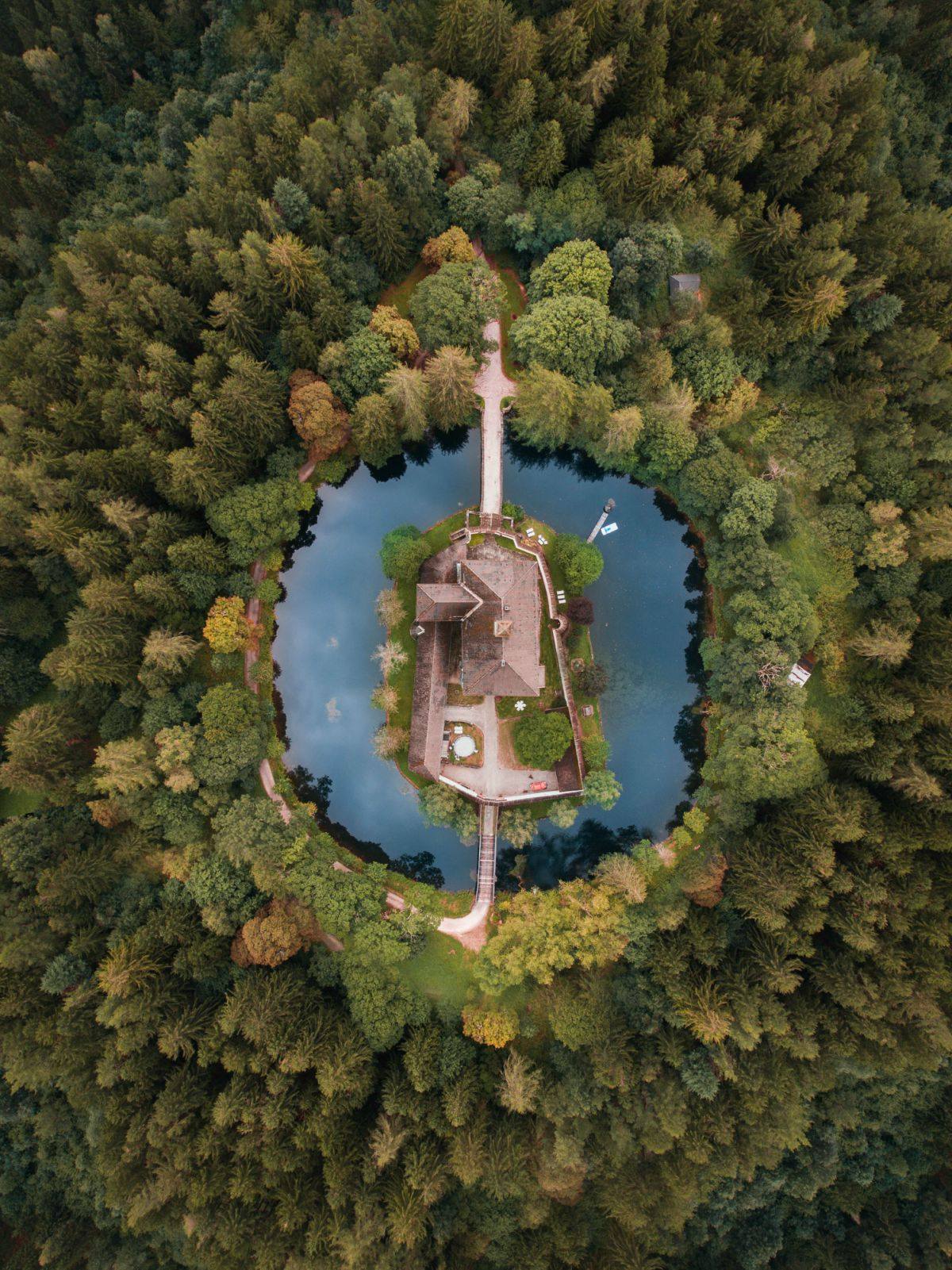 Aerial photo of house between water castle
