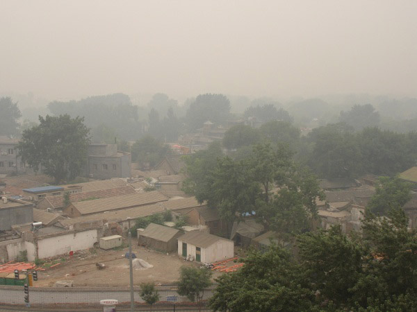 Smoke from factorys and man made pollutants lingers over China..permanantly.