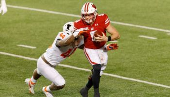 Wisconsin Badgers quarterback Graham Mertz (5) is tackled by Illinois Fighting Illini linebacker Tarique Barnes (44) during the second quarter at Camp Randall Stadium.