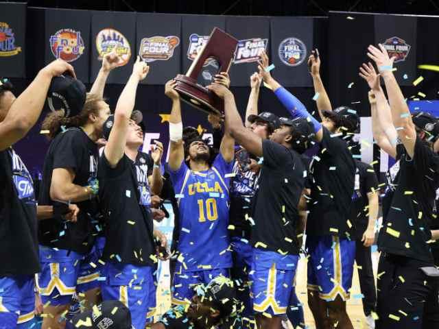 UCLA celebrates with its East Region trophy