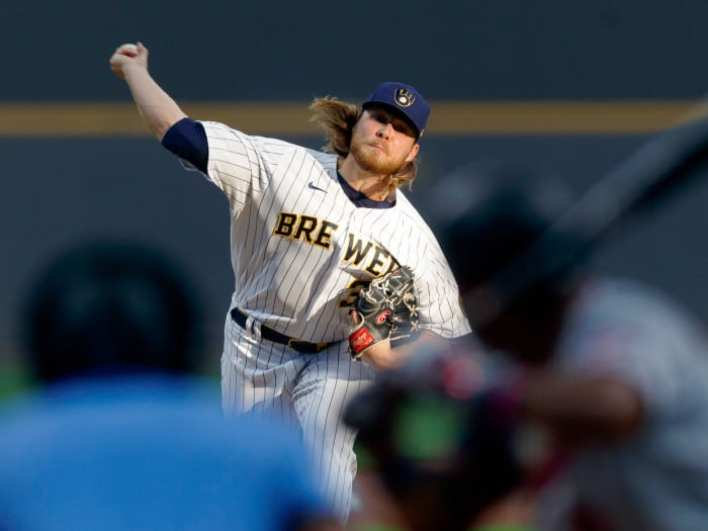 Apr 3, 2021; Milwaukee, Wisconsin, USA;  Milwaukee Brewers pitcher Corbin Burnes (39) throws a pitch against the Minnesota Twins during the first inning at American Family Field.