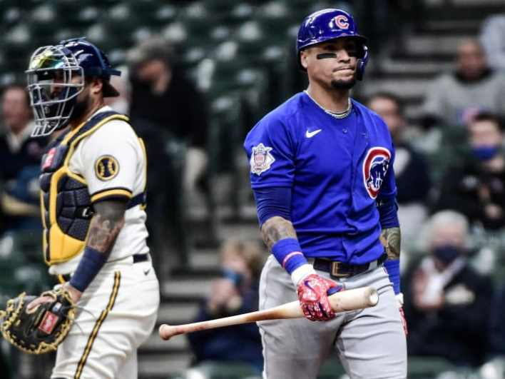 Apr 14, 2021; Milwaukee, Wisconsin, USA; Chicago Cubs shortstop Javier Baez (9) walks back to the dugout after striking out in the fourth inning during the game against the Milwaukee Brewers at American Family Field.