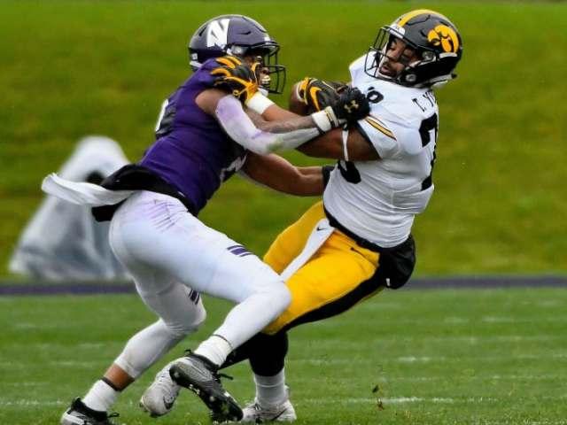 Northwestern's Greg Newsome II defends vs. Iowa