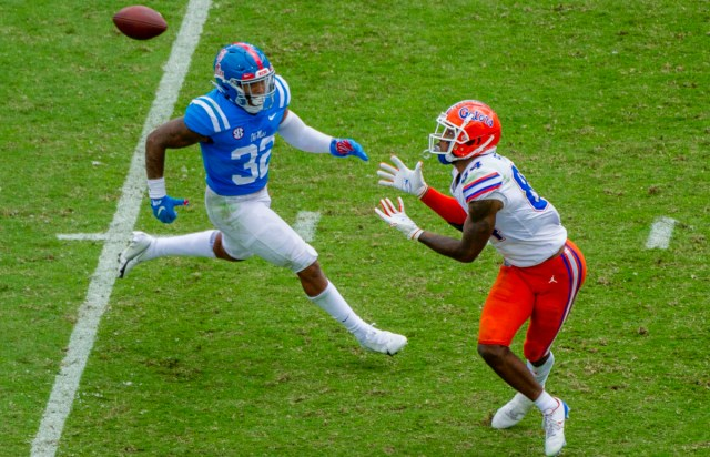 Florida Gators tight end Kyle Pitts (84) catches a pass against Mississippi Rebels linebacker Jacquez Jones (32) during the second half at Vaught-Hemingway Stadium.
