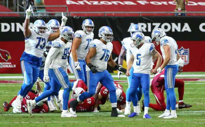 Detroit Lions kicker Matt Prater (5) celebrates his game winning field goal against the Arizona Cardinals with no time left on the clock at State Farm Stadium.