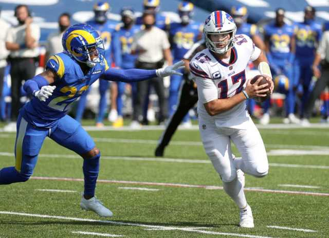 Bills quarterback Josh Allen escapes pressure from Rams Troy Hill