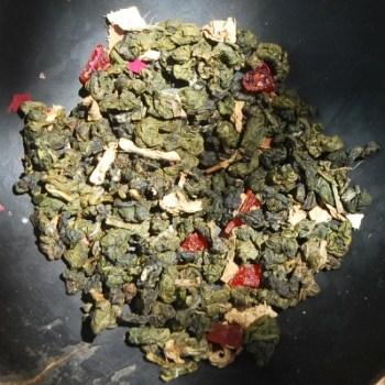 Monsoon Oolong Thai Tea Blend, dry tea leaves and aromatic ingredients