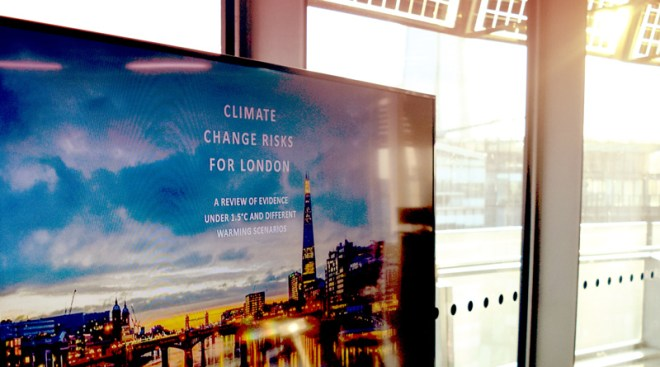 Climate risks report on screen in city hall