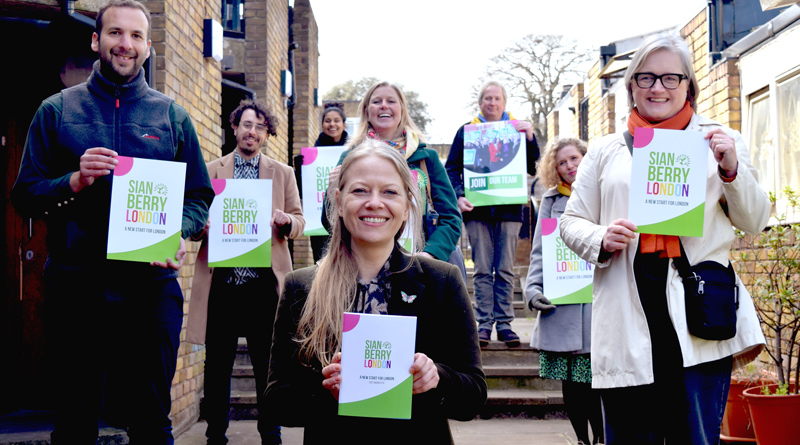 Sian Berry and Green candidates with manifesto documents