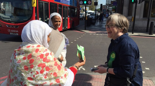 Caroline Russell with residents and bus