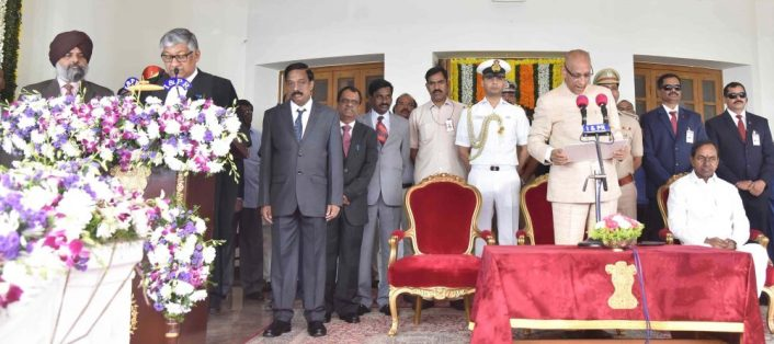 Chief Minister Sri K Chandrashekhar Rao greets Thottathil B Radhakrishnan after he took oath as first Chief Justice of the Telangana High Court, at the Raj Bhavan in Hyderaba
