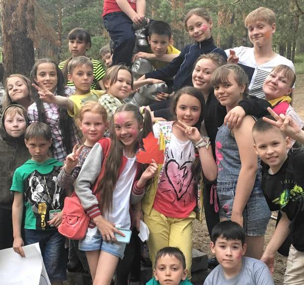 photo of children at camp with Marie