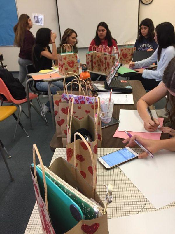 """S"" Club members making Valentine's gift bags"