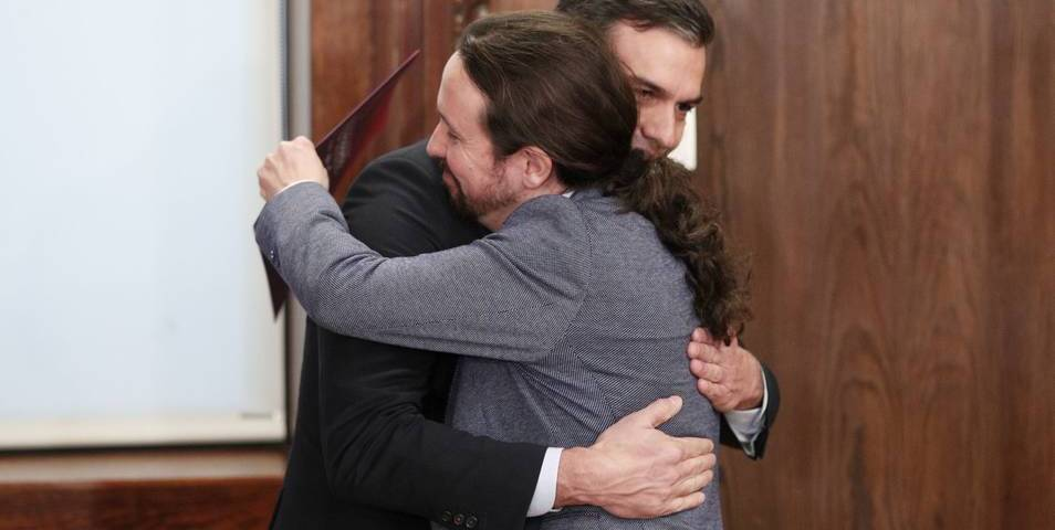 Abrazo Iglesias y Sánchez