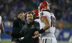 Nov 5, 2016; Lexington, KY, USA; Georgia Bulldogs head coach Kirby Smart reacts with quarterback Jacob Eason (10) during the game against the Kentucky Wildcats in the second half at Commonwealth Stadium. Georgia defeated Kentucky 27-24. Mandatory Credit: Mark Zerof-USA TODAY Sports