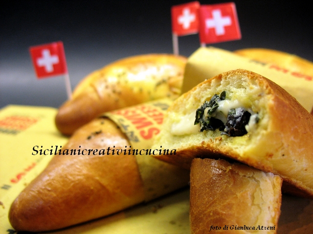 Turnovers sheep cheese with anchovies and black cabbage