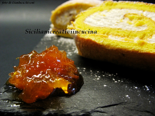 Roll with cream and orange Marmalade