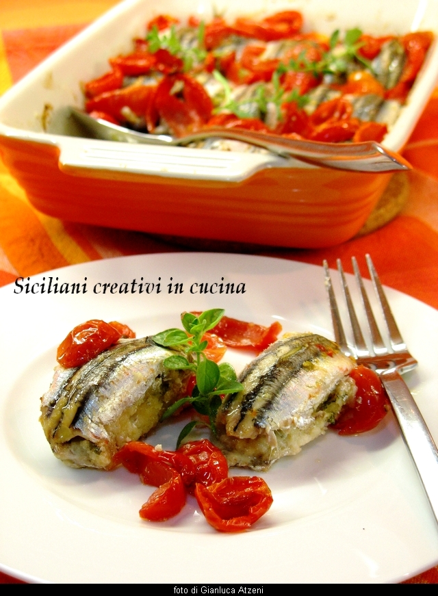 Baked stuffed anchovies, with tomatoes