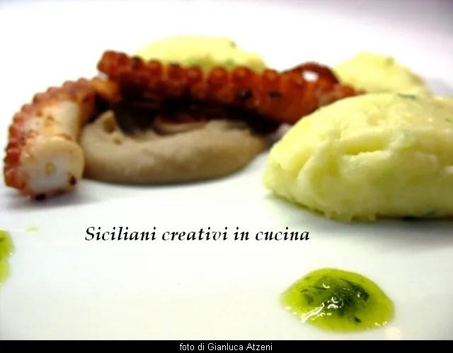 Polpo arrostito con crema di fagioli e patate al pecorino