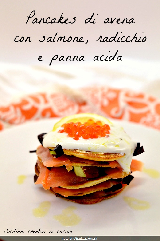 Oatmeal pancakes with salmon and sour cream