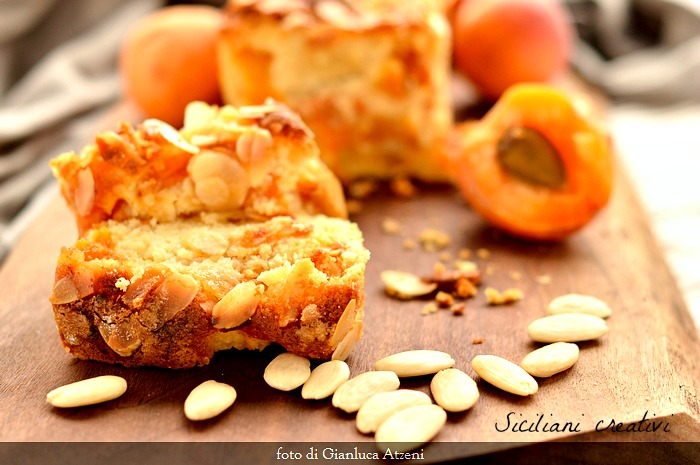 Fluffy cake at fresh apricots and almonds