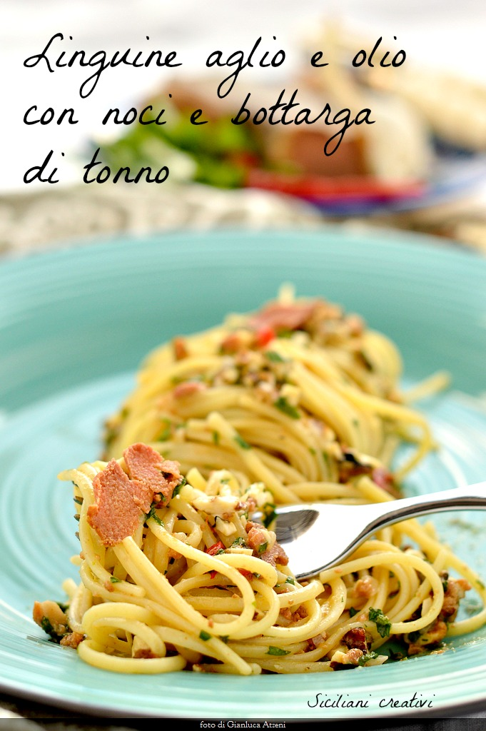 Spaghetti aglio e olio with nuts, lemon and bottarga