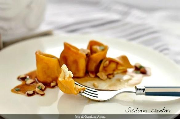 Tortelli con ricotta affumicata con sapa e nocciole