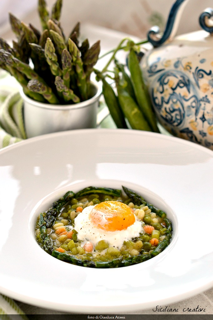 Soup of asparagus and peas, burrata cheese and poached egg