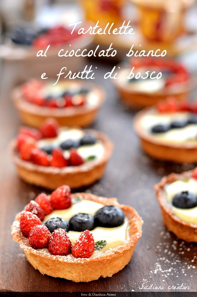 White chocolate tarts with berries