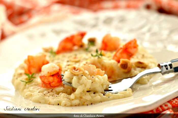 Risotto with pecorino and pepper, shrimp and hazelnuts
