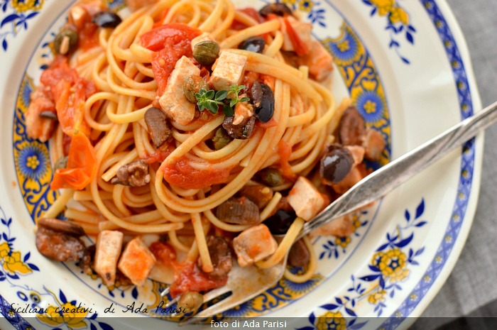 First Italian dishes: linguine with swordfish sauce Sicilian