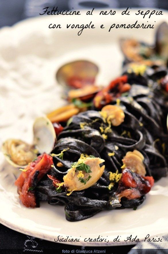 Black fettuccine with clams and cherry tomatoes