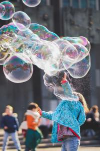 A young child plays with bubbles during a Respite in Toronto session with Side by Side Therapy