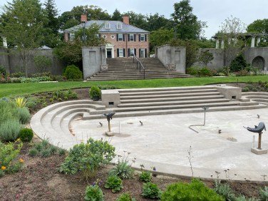 The rebuilt D-shaped pool, part of the garden's Main Axis, will soon be filled with water.