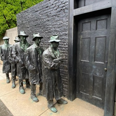 Cast in bronze, George Segal's Depression Breadline makes a powerful statement in the Sculpture Court.