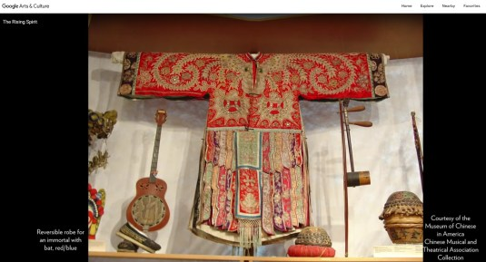 This photo of an image from the digital version of MOCA's core exhibit on Google Arts & Culture shows instruments and a costume robe for an immortal that were used in theatrical performances.