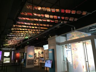 A ceiling decorated with colorful books greets visitors to the museum.