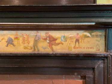 A detail from the dining-room mantel shows the Old Lyme artists at work—and play.