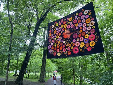 "Part of ""Cross Pollination,"" Cardinal, a 2016 digital print on silk by local artist Portia Munson, is part of her Memento Mori Mandalas series celebrating a beautiful but fragile environment."