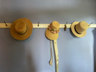 Hats hanging in the entry hall convey a sense of the Cole family's presence.