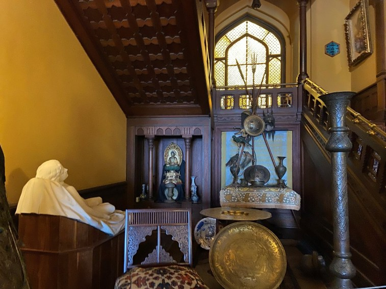 """Composed displays fill even the area below a staircase, showing Church's """"more is more"""" approach to decorating."""