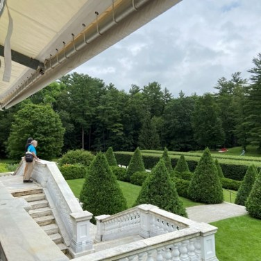 The garden and woodland views from The Mount are beautiful. On the left is an awning for The Mount's Terrace Café.