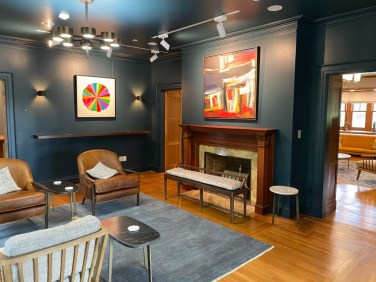 The lounges in the just-renovated Landers House display changing exhibitions; this room has two works by Sol LeWitt, who took art courses at the NBMAA.