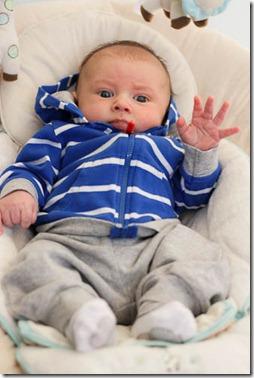 baby waving hi
