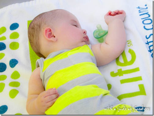 baby napping on beach