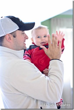 baby gives high five